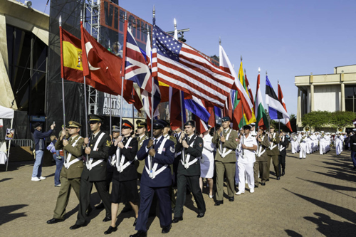Photo of soldiers carrying the country flags of NATO